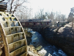 Covered bridge and water wheel at Clifton Mill