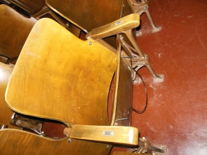 Top hat rack underneath a seat in the Wagnalls Memorial auditorium