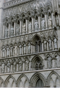 Nidaros Cathedral, Trondheim, Norway.  St. Olav is in the middle row, fourth from the left, holding an axe.