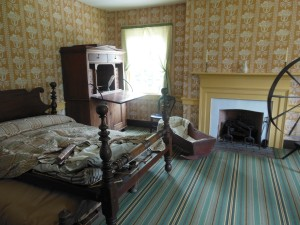 Jesse and Hanna Grant's bedroom with the cradle their children used, Grant Boyhood Home