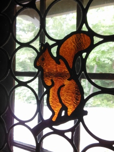 Squirrel stained glass window on a Dutch door at Aullwood