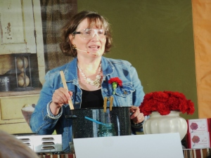 Ann Marie Craig of Century Farmhouse demonstrating how to make Red Carnation soap, Country Living Fair