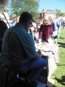 Will Moses signing a book, Country Living Fair