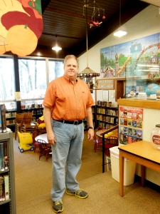 Randy Bergdorf in front of the Carole Wright Children's Room, Peninsula Library & Historical Society