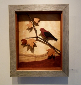 Low relief wood image of a Scarlet Tanager by Russ Shaw
