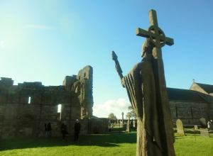 An 11-feet-high sculpture of St. Aidan stands in the churchyard of the medieval parish church of St. Mary the Virgin, overlooking the ruins of Lindisfarne Priory. The statue was made by local sculptor Kathleen Parbury and was unveiled in the presence of Elizabeth II in 1958.