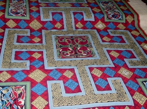 Kathleen Parbury also designed a needlepoint carpet in the sanctuary of St. Mary the Virgin that is an exact copy of the illuminated carpet page placed at the beginning of the Gospel of Luke in the Lindisfarne Gospels. Eighteen Lindisfarne seamstresses worked on the canvas for two years; it was completed in 1970.