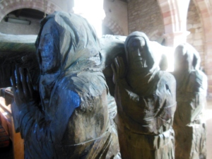 """The Journey"" is a 1999 elm-wood carving by Fenwick Lawson in St. Mary the Virgin Church on Lindisfarne. Another representation of the sculpture stands on a pedestrian street in Durham."